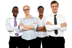 Group of business people posing with arms crossed. In front of camera Stock Images