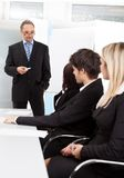 Group of business people at presentation Stock Images