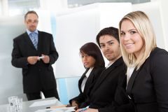Group of business people at presentation Stock Photos