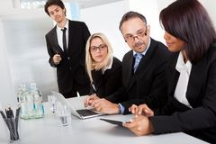Group of business people at presentation Stock Photo