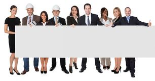 Group of business people presenting empty banner. Isolated on white stock photo