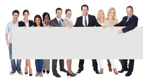 Group of business people presenting empty banner Stock Image