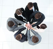 Group of business people putting their hands on top of each othe Stock Images