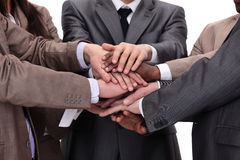 Group of business people putting their hands on top of each othe Stock Image