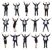 Group of business people raising arms Stock Photo