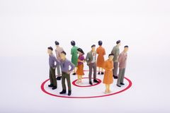 Group of business people in red circle over white. Group of business people in red circle over white background Stock Photos