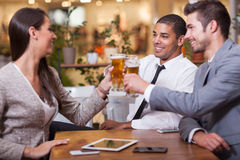 Group of business people  in restaurant toasting business succes Royalty Free Stock Images