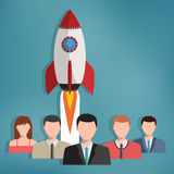 Group of business people with rocket behind them. Stock Image
