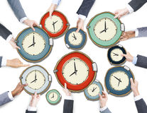 Group of Business People's Hands Holding Clocks Royalty Free Stock Photos