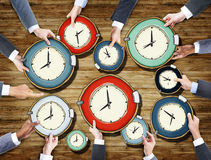 Group of Business People's Hands Holding Clocks Royalty Free Stock Images