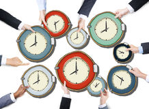 Group of Business People's Hands Holding Clocks Stock Image