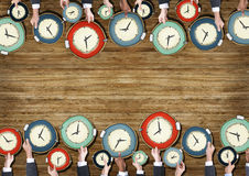 Group of Business People's Hands Holding Clocks Royalty Free Stock Photo