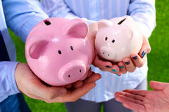 Group of business people saving money on the piggy Royalty Free Stock Images