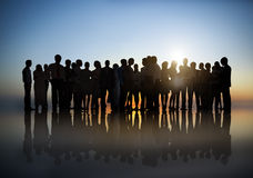 Group Of Business People In A Setting Sun Stock Photography