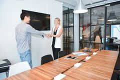 Group of business people shaking hands in a meeting room royalty free stock images