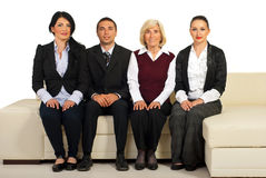Group of business people sit on couch Stock Photography
