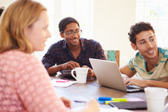 Group Of Business People Sitting Around Table In Meeting Royalty Free Stock Photography