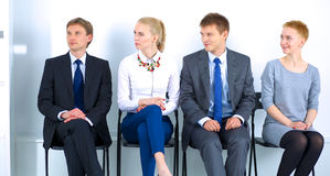 Group of business people sitting on chair in Royalty Free Stock Photos