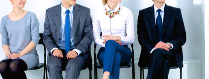 Group of business people sitting on chair in Stock Photos