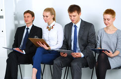 Group of business people sitting on chair in office.  Stock Photo