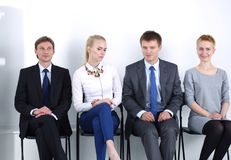 Group of business people sitting on chair in office . Group of business people.  Stock Photo