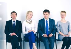 Group of business people sitting on chair in office . Group of business people.  Royalty Free Stock Photo