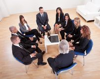 Group Of Business People Sitting On Chairs Stock Photos