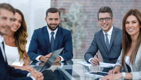 Group of business people sitting at the Desk. The concept of teamwork royalty free stock photography