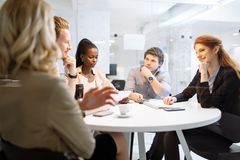 Business people collaborating in office and working on project together royalty free stock photography