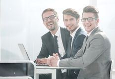 Group of business people sitting at the Desk stock photography