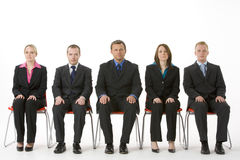 Group Of Business People Sitting In A Line stock photography