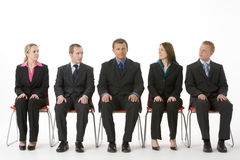 Group Of Business People Sitting In A Line Royalty Free Stock Images
