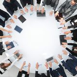 Group of business people sitting at the round table, and putting his palms on the table Stock Images