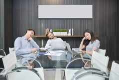 Group of business people sleeping in meeting room with blank pic royalty free stock photos