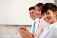 Group of business people smiling at you Stock Photography