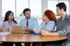 Group of business people and software developers at work Stock Photos