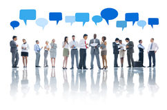 Group of Business People and Speech Bubbles Royalty Free Stock Images