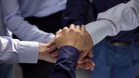 Group of business people stacking hands, team building training, cooperation. Stock photo stock image