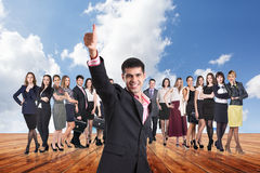 Group of business people stand under clouds sky. Royalty Free Stock Photos