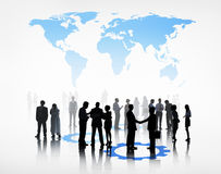 Group Of Business People Standing Beneath The World.  Royalty Free Stock Photo