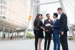 Group of business people standing in the city and discussing ideas for business future. Multi culture of business people, African, Caucasian and Asian royalty free stock photos