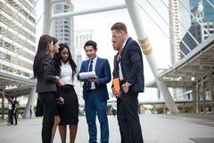 Group of business people standing in the city and discussing ideas for business future. Multi culture of business people, African, Caucasian and Asian royalty free stock images