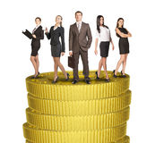 Group of business people standing on coins stack Stock Images