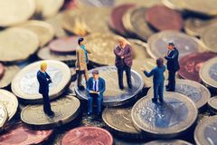 Group of business people standing on euro money stack. And talking Royalty Free Stock Image