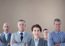 Group of business people standing in front of brown background Royalty Free Stock Images