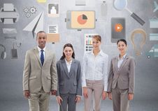 Group of business people standing in front of business and office graphics Stock Photos