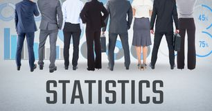 Group of business people standing in front of statistics performance charts. Digital composite of Group of business people standing in front of statistics Stock Photo