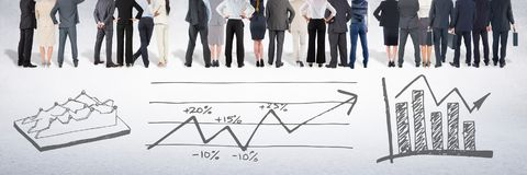 Group of business people standing in front of statistics performance charts drawings stock images