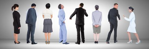 Group of Business People standing with grey vignette Royalty Free Stock Photography