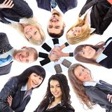 Group of business people standing in huddle Stock Image